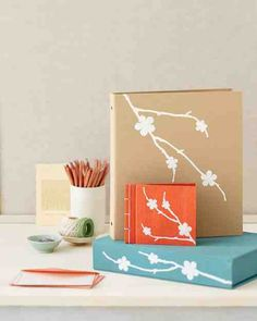 Floral-shaped iron-on transfers give cloth-covered binders and albums a modern, screen-printed look.