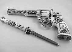 Custom engraved switchblade to match custom colt revolver. Beautiful works of art.