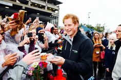 hrhroyalty:  Trip to New Zealand, Christchurch, May 12, 2015-Prince Harry handed out cup cakes during a visit to University of Canterbury, Student Volunteer Army