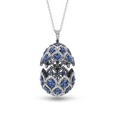 Fabergé Zenya Sapphire Egg Pendant features round white diamonds and round blue sapphires set in 18 carat rhodium-plated white gold. The egg pendant is 26mm.