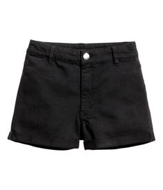 Black. Shorts in washed stretch twill with a high waist, zip fly with button, and sewn cuffs at hems.