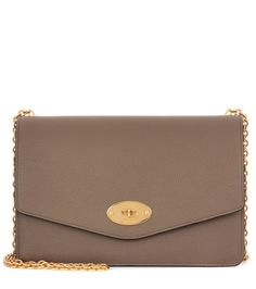 Mulberry - Darley leather clutch - The postman's lock fastening is an iconic Mulberry signature, and we love the way it looks against the classic taupe leather of this Darley clutch. Crafted with a grainy finish, this style comes with a zipped internal pouch and card slots for optimal organisation. Carry yours neatly in hand in or attach the golden shoulder chain to go hands-free. seen @ www.mytheresa.com