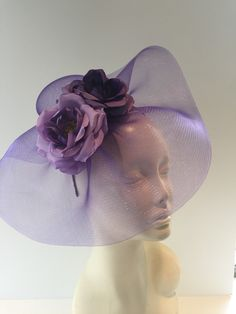 A personal favorite from my Etsy shop https://www.etsy.com/listing/278005992/lilac-fascinator-rose-headband-flower