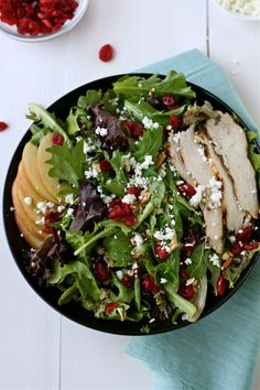 Salad with chicken, apples, dried cranberries, goat cheese