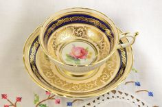 Paragon Rose tea cup and saucer richly gilded rose paragon