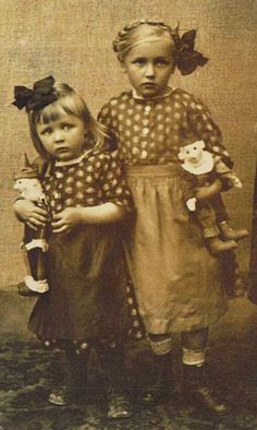 Sisters with dolls.