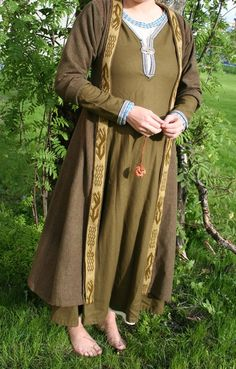 Birka coat by Ingrid Galadriel, with Evebo tablet weaving along the front edges