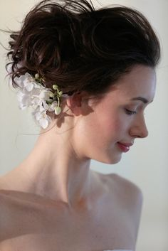 The hair at Angel Sanchez by Fekkai was a floral arrangement that went from ear to ear in a diagonal design.