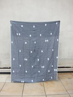 "Linen Throw ""Nenga"" from carolinezhurley.bigcartel.com.  Becoming very drawn to charcoal and white fabric designs"