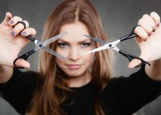 Professional hairdresser with scissors ready to cut.