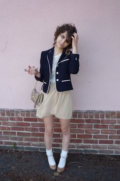 White frilly ankle socks, brown pumps, simple beige skirt, white tee-shirt, night blue jacket
