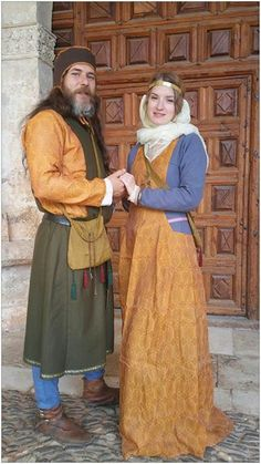 Spanish 13th Century. Noble man and lady. Al-andalus silks, Castilian wools and linens. Caballeros de Ulver historical reenactment.