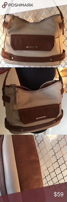 🎁SALE! STONE MOUNTAIN SHOULDER BAG 💯 AUTHENTIC STONE MOUNTAIN SHOULDER BAG 💯 AUTHENTIC. STUNNING AND ALWAYS STYLISH. THIS BAG HAS 2 EXTERIOR POCKETS, THREE MAIN COMPARTMENTS AND 4 WALL POCKETS. THE BAG MEASURES 13 INCHES WIDE BY 9 INCHES TALL. RHE SHOULDER STRAP HAS A 8 INCH DROP Stone Mountain Bags Shoulder Bags