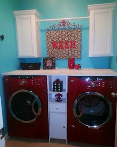 The hubby painted our laundry room!  I'm in love with this shade of aqua against my red appliances!