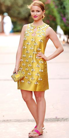 Dianna Agron wearing a jeweled shift, clutch to match, and neon flats.