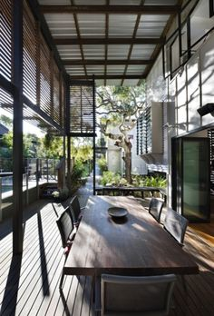 Modern house interior with dining room table and garden