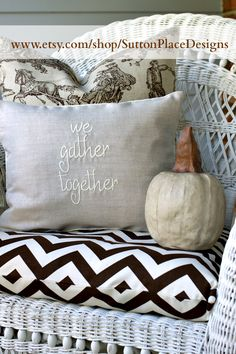 Linen pillow cover embroidered with the phrase We Gather Together available at Sutton Place Designs on Etsy.