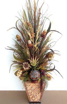 Dried preservative flower arrangement. Designed by Arcadia Floral & Home Decor