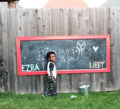 How to make an outdoor chalkboard- perfect for a play area in the yard or garden!