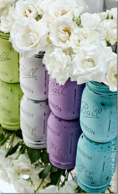Oooh absolutely love these bright mason jars against the white flowers.