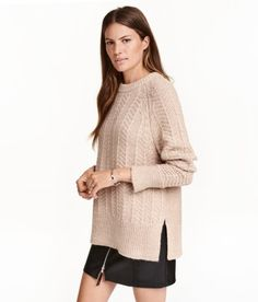 Check this out! Sweater in a soft, textured knit with wool content. Long raglan sleeves with slits at cuffs and ribbing at cuffs and hem. - Visit hm.com to see more.