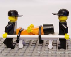 """By: Legofesto / LEGO recreation of the transport and imprisonment of """"enemy combatants"""" at Guantanamo Bay / c.  2007"""