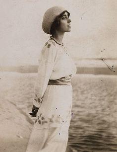 * Elsa Schiaparelli, in a dress she designed, visiting the seaside around 1915 vintage fashion designer style icon genius found photo 1910s to 1920s portrait