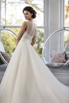 W137 - Full skirted bridal gown with embroidered bodice and pretty beaded sheer back. Full tulle circle skirt with zip up back and button trim