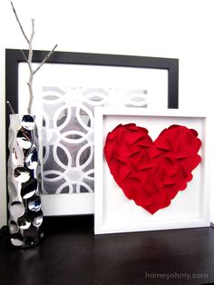 This DIY Heart Wall Art from Homey Oh My looks like an ordinary piece of wall art, but I was blown away by the process of how she created it.  You have to see this!