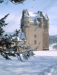 Image of Castle Fraser Snow Scenic White Tower Turrets Tree Branches Aberdeenshire Scotland dates from between 1575 and 1636 | Jim Henderson