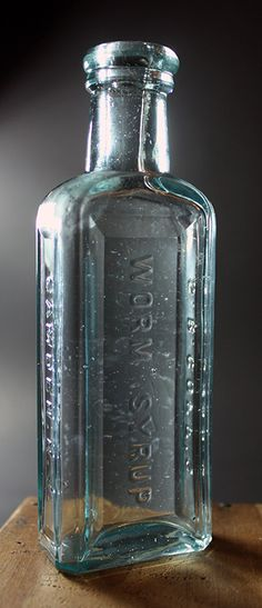 Goff's Worm Syrup - aqua, tooled double ring lip, rectangular, 5 1/16in (129mm) tall. Embossing: WORM SYRUP (down back), S.B. GOFF'S (down side), CAMDEN, N.J. (down other side) - c1895 Old Medicine Bottles, Old Glass Bottles, Antique Bottles, Vintage Bottles, Pineapple Upside, Double Ring, Camden, Syrup, Vodka Bottle