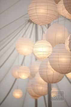 we are loving how they used crisscross ribbing paper lanterns. this is artistic and lovely at the same time