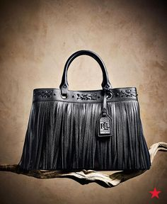 The perfect bag for work and beyond, Lauren Ralph Lauren's Barton Emery tote features bohemian cross-stitch and fringe details. We're already imaging how chic this would look strutting down the street! Pick up yours now at Macy's.