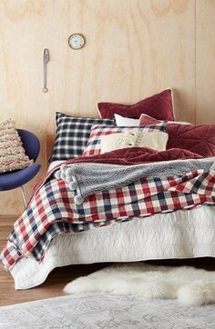 Classic checks add to the vintage appeal of this channel-stitched quilt cut from warm flannel. Reverse the style to blue plaid to change up the look of the bedroom.