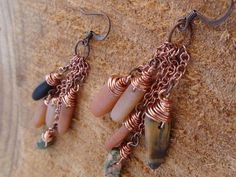 the long and short earrings by jeweldesignsbyred on Etsy, $24.00