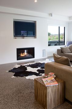 A Gas fire place is well positioned in the living area.