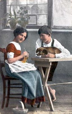 Image: Woman knits, bot with dog watches