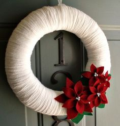DIY Christmas wreaths made out of swim noodle, yarn and other decorations.