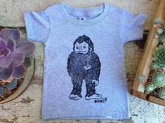 Items similar to Little Whistler Sasquatch Toddle Tee on Etsy Mysterious Things, Whistler, Printed Tees, Hand Carved, Art Ideas, Original Art, Coast, T Shirts For Women, Inspired