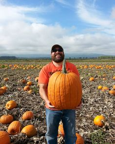 This guy. That beard. Those muscles. My husband is such a handsome man!  Also: Check out the humongous pumpkin! We're going to have aaaall the pumpkin seeds we could ever want! by livinglifeunscripted