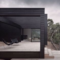 This rural residence outside Melbourne by architects Studio Four features a blackened timber exterior and terraces that step down a hill. We're featuring some of the best black houses on Instagram today, and there's even more examples on dezeen.com/tag/black-houses #architecture #house #Melbourne