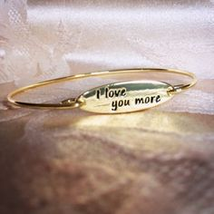 """I love you more"" Bangle Bracelet VALENTINES DAYGold plated lowercase ""i love you more"" custom made inscribed bangle bracelet.  Not available anywhere but here. Such a unique adorable piece. Secure hook closure. Item always rated 5 stars by buyers. No lowball offers pls. This bracelet will fit a large wrist. Jewelry Bracelets"