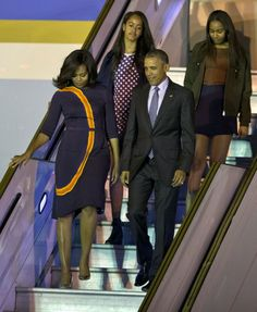 <p>Following a few monumental days in Cuba, President Obama & co. moved onto Argentina, continuing the family's epic spring break. The first lady looked to designer Narciso Rodriguez, a favorite of hers, for the flight, opting for a navy blue dress with an abstract motif.<i>Photo: AP</i></p>