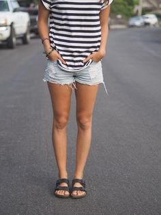 Navy striped tee with jean cutoffs and navy Birken…