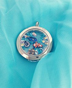 Life in a fishbowl! #origamiowl #locketscience #summer #clownfish #sandcastle #shell #fish #locket Find me on Facebook : www.facebook.com/origamiowljulieperez Instagram & twitter : @locketscience Shop : https://jeperez.origamiowl.com