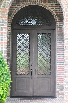 Would be even prettier if brick was painted white Iron Front Door, Iron Doors, Front Entry, Entry Doors, Burglar Bars, Door Grill, House Under Construction, Window Bars, Security Gates