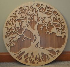 This detailed Tree of Life features is ready to hang. It measures about 16 inches across. It can be ordered without the wood backing if you would like