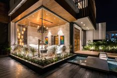 A House in Panchkula with Glass Walls and an Elevated Pool - Design Milk