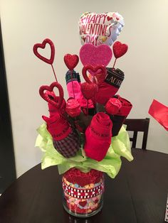 A Broquet. A bouquet for boys for valentines Day! I made mine using red & pink men's underwear! Affordable DIY Valentines Gift for him!