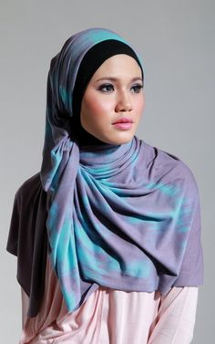 Looks like a large square jersey knit hijab scarf, but I'm not certain. Love the look, nonetheless!